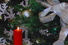 Red candle, snowflakes, golden ribbon and holiday decorations Stock Footage