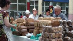 Russian lady selling bread on Tajik bazaar, Central Asia, former Soviet Union Stock Footage