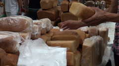 Packing loaves of bread in Tajik bazaar, bakery in Central Asia Stock Footage