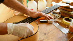 Luthier varnishing a guitar Stock Footage