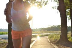 Young woman running and working out in the park Stock Photos