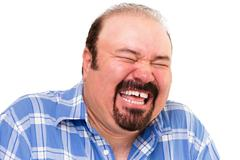 Caucasian bearded happy man laughing loud Stock Photos