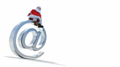 Christmas clip of Santa  Claus sitting on an at symbol Stock Footage