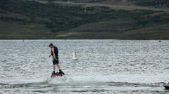 Summer lake Fly Board passing boats fun HD 9522 Stock Footage