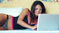 Attractive business woman in lingerie working with laptop at the hotel Stock Footage