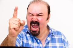 Angry middle-aged man screaming and threatening Stock Photos