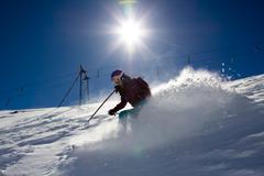 Sunny woman skier Stock Photos
