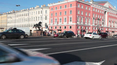 Traffic on Nevsky Avenue across Anichkov Bridge, Saint-Petersburg, Russia Stock Footage