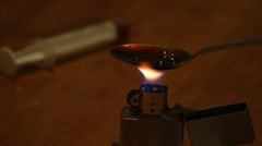 Drugs cooking with zippo Stock Footage