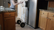 Stock Video Footage of moving a refrigerator 2