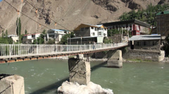 Footbride in Khorog, fast flowing river in small town Tajikistan Stock Footage