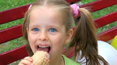 Child eating ice-cream outdoor. Stock Footage