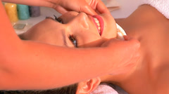 Stock Video Footage of Woman getting facial massage in beauty spa.