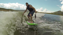 Wake Board learning to ride the wave behind a boat HD 0013 Stock Footage