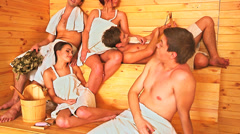 Group people in Santa hat relaxing at sauna. Stock Footage