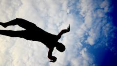 Five parkour free runners backlit silhouette Stock Footage