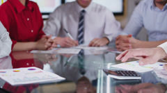 Stock Video Footage of Business team in meeting, hands reach across the table to shake hands on a deal