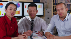 Attractive mixed ethnicity business team take a conference call Stock Footage