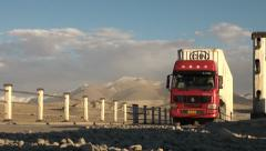 Chinese cargo truck, Pamir Highway, bridge, Tajikistan Stock Footage