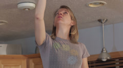 Changing a light bulb 2 Stock Footage