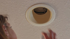 Changing a light bulb 1 Stock Footage