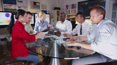 Diverse business group discuss profits & loss in a boardroom meeting Stock Footage