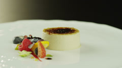 Creme Brulee Dessert with Berries on White Plate 4K Stock Footage