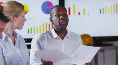 Attractive business group discuss ideas in a boardroom meeting - stock footage