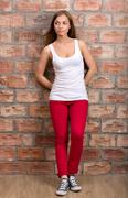 Casual design girl in red trousers Stock Photos