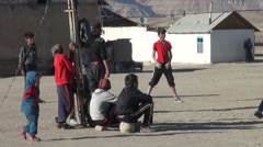 Tajikistan, local volleyball game, spectactors, kids, community, settlement Stock Footage
