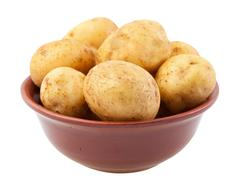 Young potatoes in a clay bowl Stock Photos