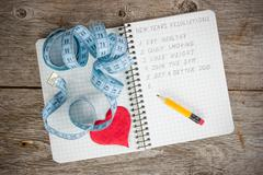 resolutions written on a notepad - stock photo
