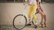 Nice young couple of model on vintage bike Stock Footage