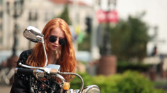 Cute girl with red hair and the old motorbike Stock Footage