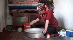 Girl kneading dough in Tajik home Stock Footage