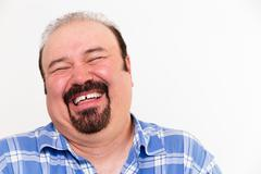 cheerful middle-aged caucasian man laughing loud - stock photo