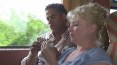 Young couple enjoy the meal breakfast sandwich train travel feeding happy Stock Footage