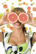 Grapefruit and glasses Stock Photos