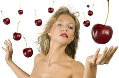 blond girl with cherry - stock photo