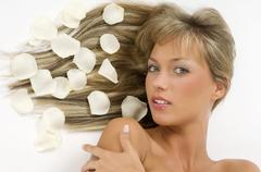 blond girl petals - stock photo