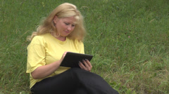 Business woman work on computer tablet garden, meadow holiday girl touchscreen Stock Footage