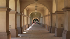 San Diego Balboa Park tourism museum arched walk HD 9105 Stock Footage