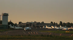 Speed up of Utair Ukraine ATR 72-500 steering evening airport Stock Footage