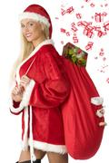 blond santa claus with bag - stock photo