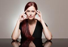 Redhead beauty with strong facial expression. Stock Photos