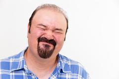 Expressive face on a man Stock Photos
