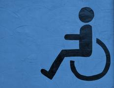 The symbol handicapped on blue wall background Stock Photos
