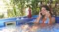 businesswoman on the cell phone relaxing whirlpool bath - jacuzzi drinking wine Footage