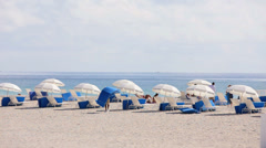Umbrellas on the beach Stock Footage