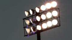 Stadium lights with bugs flying around them Stock Footage